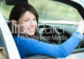 Portrait of a smiling woman driving