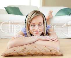 Relaxed woman listening music lying on the floor