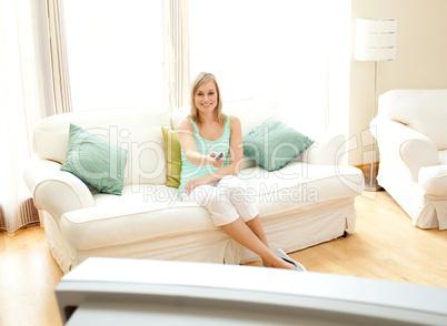 Happy Caucasian woman watching TV