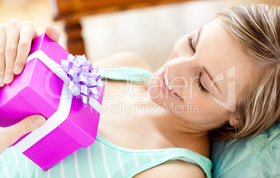 Happy woman holding a present