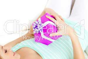 Charming woman holding a present