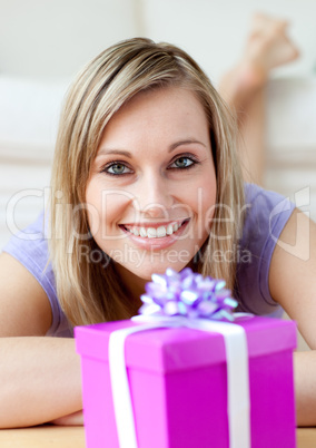 Cheerful woman looking at a gift