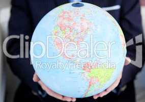 Close-up of a business person holding a terrestrial globe