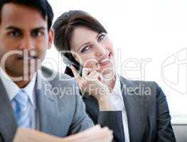 Confident businesswoman on phone sitting on a sofa