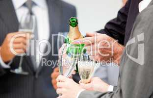 Close-up of a businessman serving Champagne