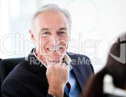 Charismatic senior businessman in a meeting
