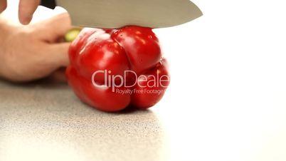Man slice red pepper