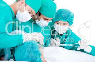 Professionnal medical team using surgery equipment on a patient