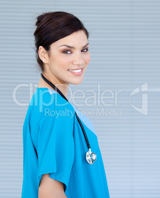 Beautiful female doctor looking at the camera