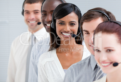 Multi-ethnic customer service representatives standing in a line