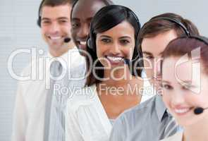 Multi-ethnic customer service representatives standing in a line