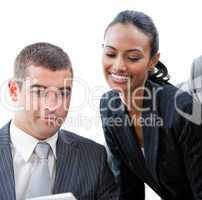 Charming businesswoman helping a colleague in a meeting