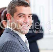 Close-up of a smiling businessman at a presentation