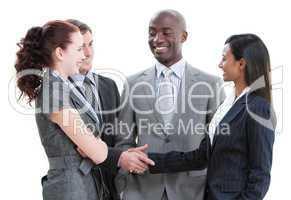 Jolly business partners shaking hands standing