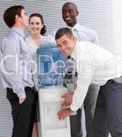 Confident multi-ethnic business people interacting at a watercoo