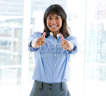 Successful female executive with thumbs up standing