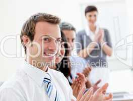 Smling business people applauding a good presentation