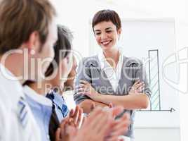 Happy business people applauding a good presentation