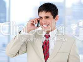 Laghing businessman talking on phone standing