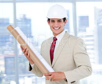 Confident architect holding a blueprint