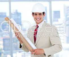 Confident architect holding a blueprint