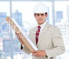 Handsome architect holding a blueprint