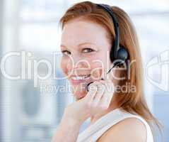 Smiling sales representative woman with an headset