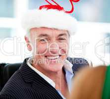 Mature businessman celebrating christmas
