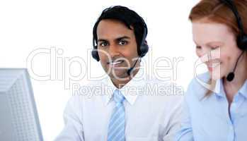 Self-assured sales representative partners with headsets against