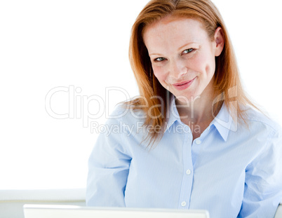 Nice business woman working on a laptop computer