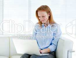 Cute business woman working on a laptop computer