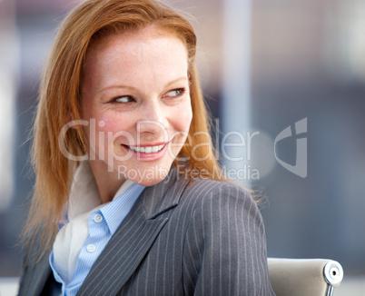 Nice business woman looking behind her