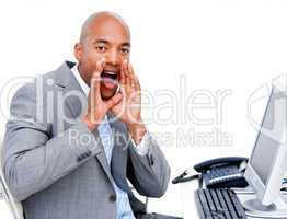 Afro-american businessman yelling sitting at his desk