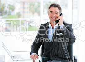 Confident mature businessman talking on phone