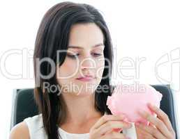 Beautiful businesswoman holding a piggybank