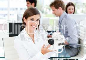 Smiling businesswoman looking for a contact in her white cards