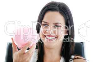 Laughing businesswoman holding a piggybank