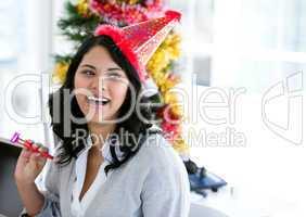 Positive businesswoman celebrating christmas