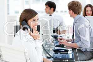 Enthousiastic businesswoman talking to the phone