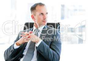 Confident  businessman thinking about the company