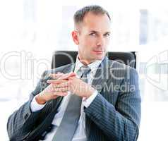 Self-assured businessman looking at the camera