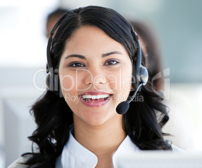 Beautiful businesswoman wearing a headset to talk with customer