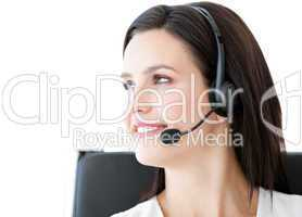 Confident  businesswoman wearing a headset to talk with customer