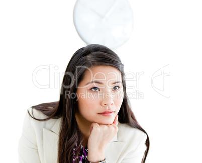 Portrait of a pensive Asian businesswoman