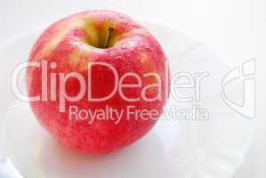 Red apple on a plate