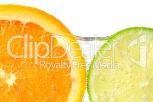 Orange and lime slices in water