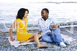 Happy couple sitting at beach