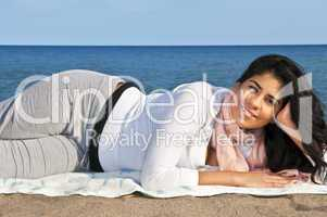 Young native american woman at beach