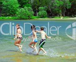 Children running into water