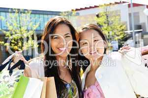 Young girlfriends shopping